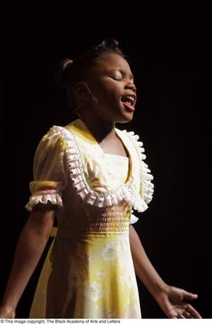 Primary view of [Young singer in spotlight]