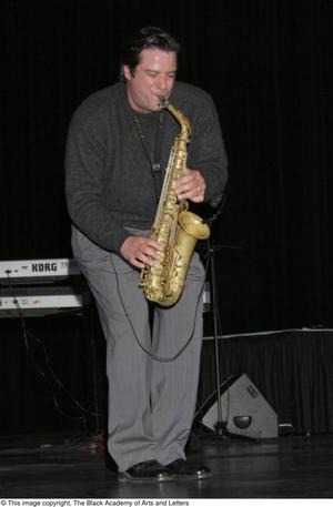 Primary view of object titled '[Man playing a saxophone]'.