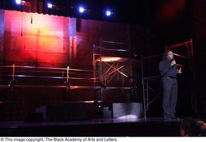Primary view of object titled '[Curtis King onstage Aretha: The Musical]'.