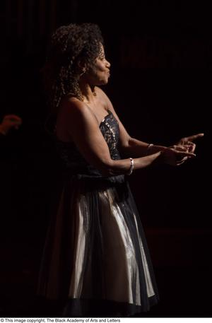Primary view of [Performer singing on stage]