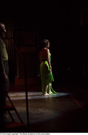 Primary view of object titled '[Performer in green dress and dancer on stage]'.