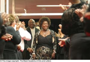 Primary view of object titled '[Crowd Applauding Tramaine Hawkins]'.
