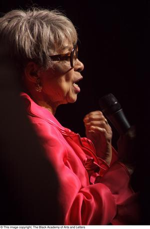 Primary view of object titled '[Ruby Dee speaking on stage]'.