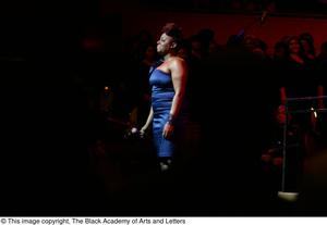 Primary view of object titled '[Ledisi standing on stage]'.