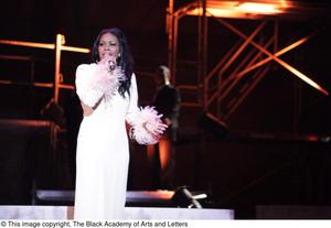 Primary view of object titled '[Actress performs solo during Aretha: The Musical]'.