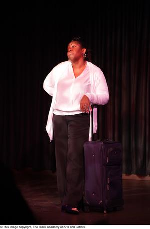 Primary view of object titled '[Performer leaning on suitcase]'.