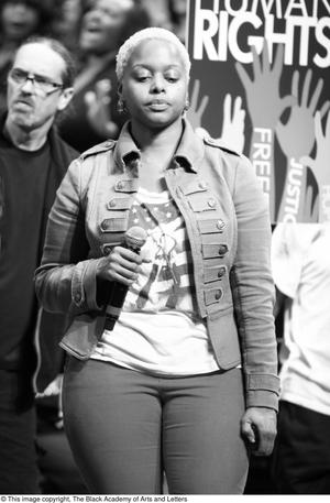 Primary view of object titled '[Chrisette Michele standing on stage]'.