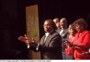 Primary view of object titled '[Curtis King gesticulating on stage]'.