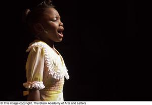 Primary view of [Young performer in spotlight]