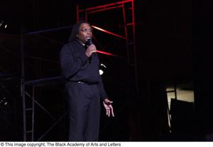 Primary view of object titled '[Curtis King speaking in front of the set at Aretha: The Musical]'.