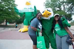 Primary view of object titled '[Students pose with Scrappy at UNT Grad Block Party]'.
