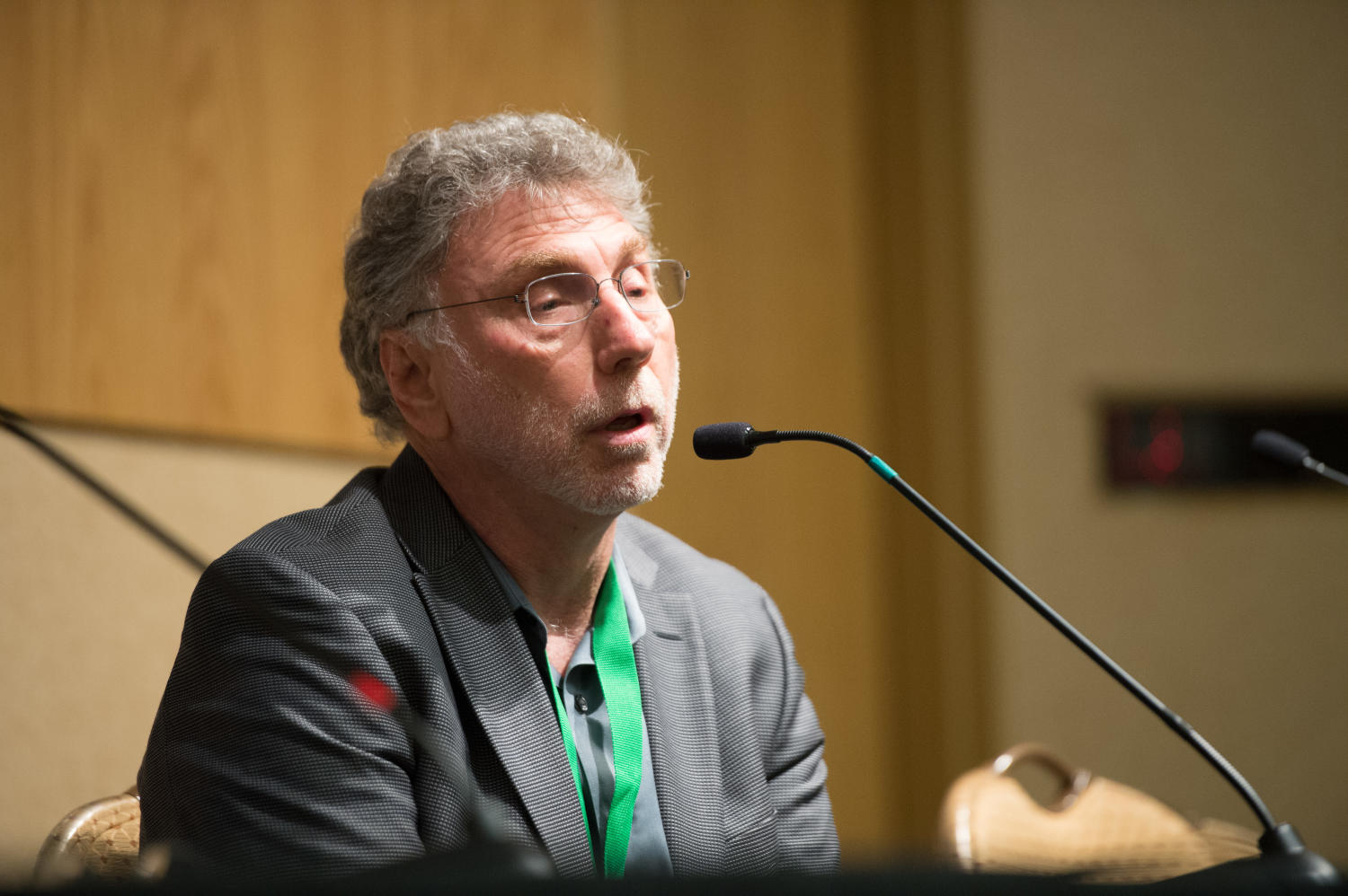 """[Marty Baron speaking during """"Spotlight On Winning Pulitzers"""" plenary], Photograph of Marty Baron speaking into a microphone during a plenary titled """"Spotlight On Winning Pulitzers - Confessions of an 11-Time Pulitzer Prize Winning Editor"""". The event was held as a part of the Mayborn Literary Nonfiction Conference at the Hilton DFW Lakes Executive Conference Center, Grapevine, TX.,"""