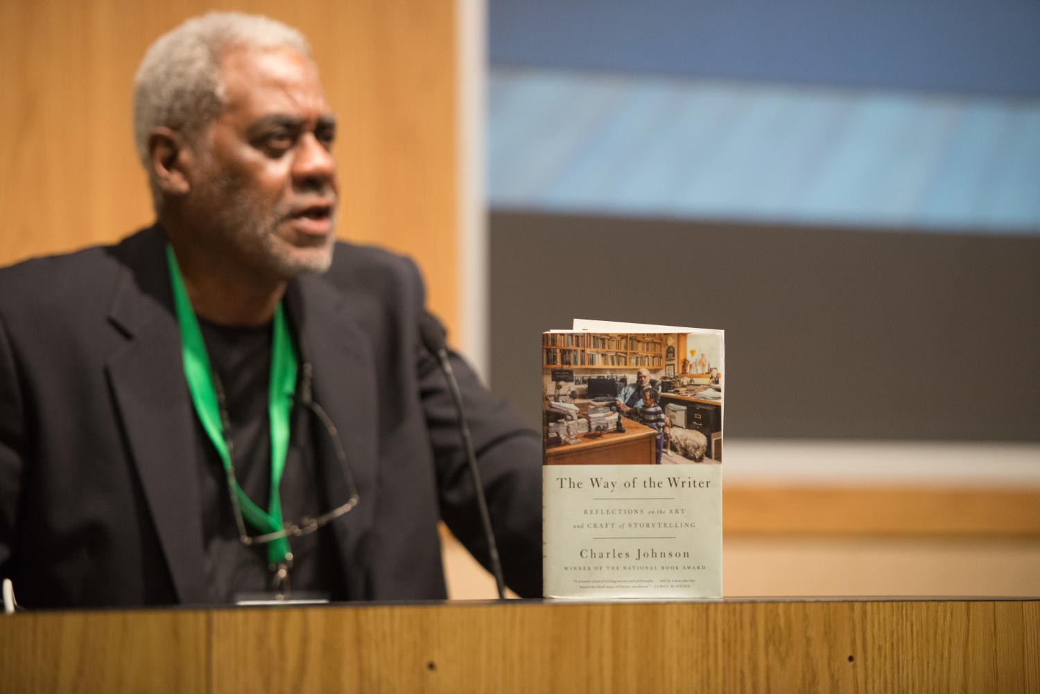 """[Charles Johnsons book], Photograph of Dr. Charles Johnson, a professor emeritus at the University of Washington and author of the book """"The Way of the Writer"""", standing at a podium during his keynote. The event was held during the 2017 Mayborn Literary Nonfiction Conference at the Hilton DFW Lakes Executive Conference Center in Grapevine, TX.,"""