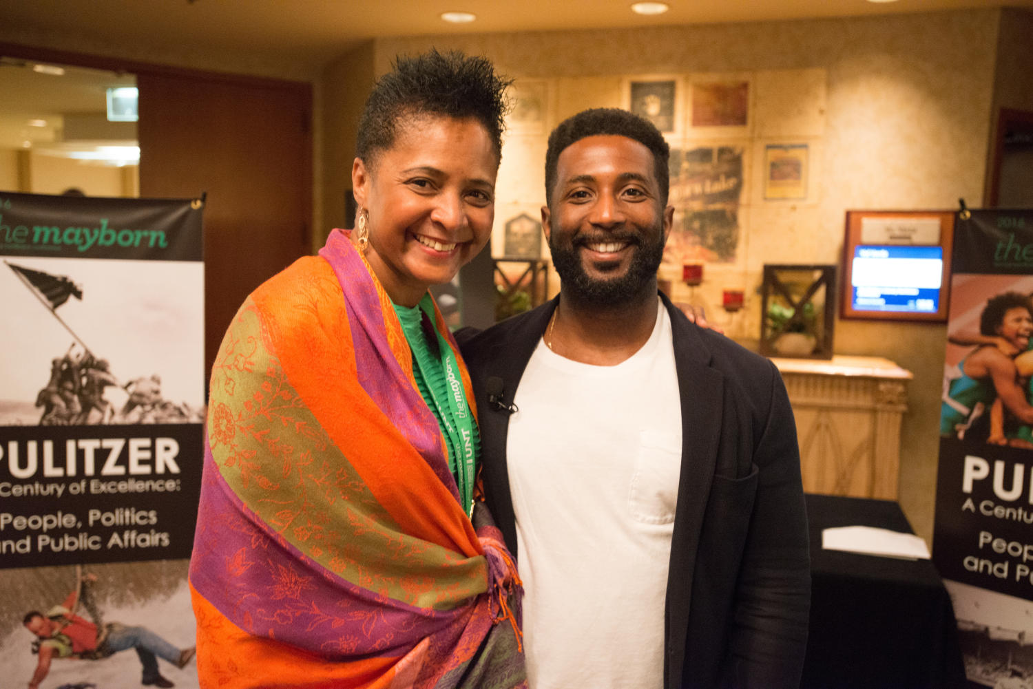 [Dorothy Bland and Wesley Morris standing together], Photograph of Dorothy Bland, the Dean of the Mayborn School of Journalism, and Wesley Morris, a critic-at-large with The New York Times, standing together after Margo Jeffersons keynote event. The keynote, which Morris acted as moderator for, took place during the Mayborn Literary Nonfiction Conference. They are standing in the hallways of the Hilton DFW Lakes Executive Conference Center, Grapevine, TX where the conference was held.,