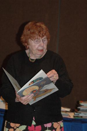 Woman reading children's book at CSLA conference, CSLA 2006