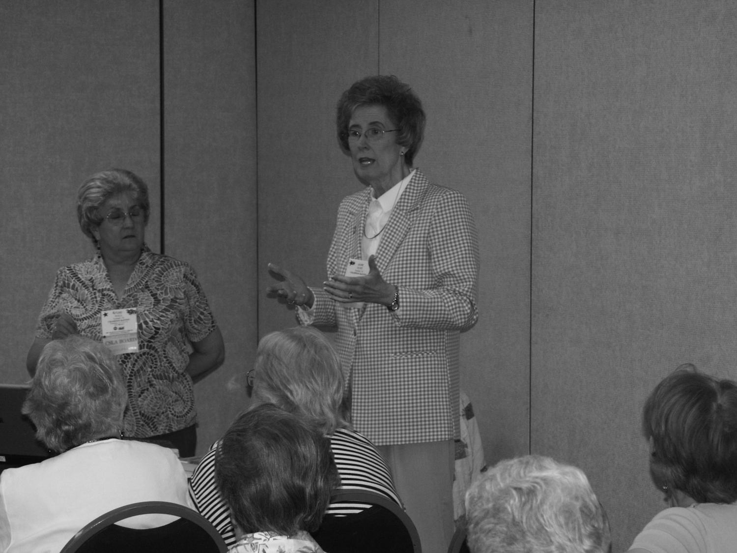 [Alrene Hall and Jane Hope speaking to attendees], Photograph of Alrene Hall (left) and Jane Hope (right), presenters giving a lecture on the use of Book Systems library software, Concourse, during a workshop. The two women are giving a workshop titled, Concourse and EZCat: An Introduction during the 40th anniversary Church and Synagogue Library Association conference held at the Inn at Valley Forge in King of Prussia, Pennsylvania.,