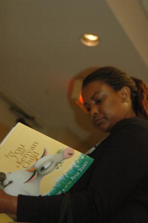 Attendee holding children's book, CSLA 2007