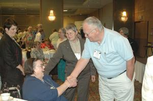 Primary view of [Warren Livingston shaking hands with guest at CSLA conference]