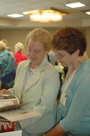 Two women looking at children's book, CSLA 2007