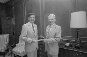 Primary view of object titled '[Dr. Robert Toulouse with President Hurley]'.