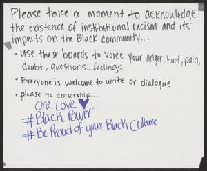 A poster with only writing on it. The hashtags at the bottom are written in blue, and the rest in black. The poster is protesting institutional racism.