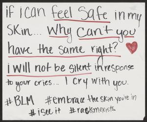 A poster in black marker, some words underlined in red, a red heart next to them. The hashtags written at the bottom say BLM, embrace the skin you're in, i see it and racist exists.