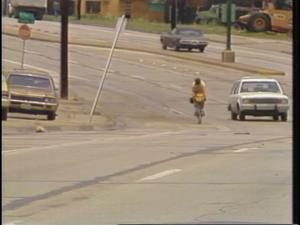 Primary view of [News Clip: Cross Country Cyclist]