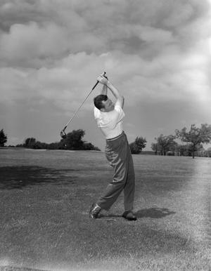 [Gordon Fitzgerald swinging a golf club]