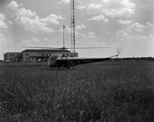 Primary view of [Helicopter in front of the WBAP building]