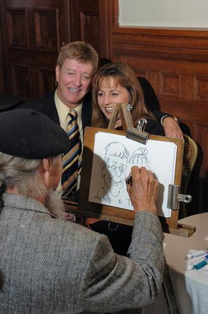 [Caricature artist drawing couple at TDNA conference]