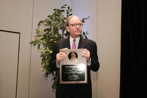 [Jeremy L. Halbreich holding award for Vic Odegar]