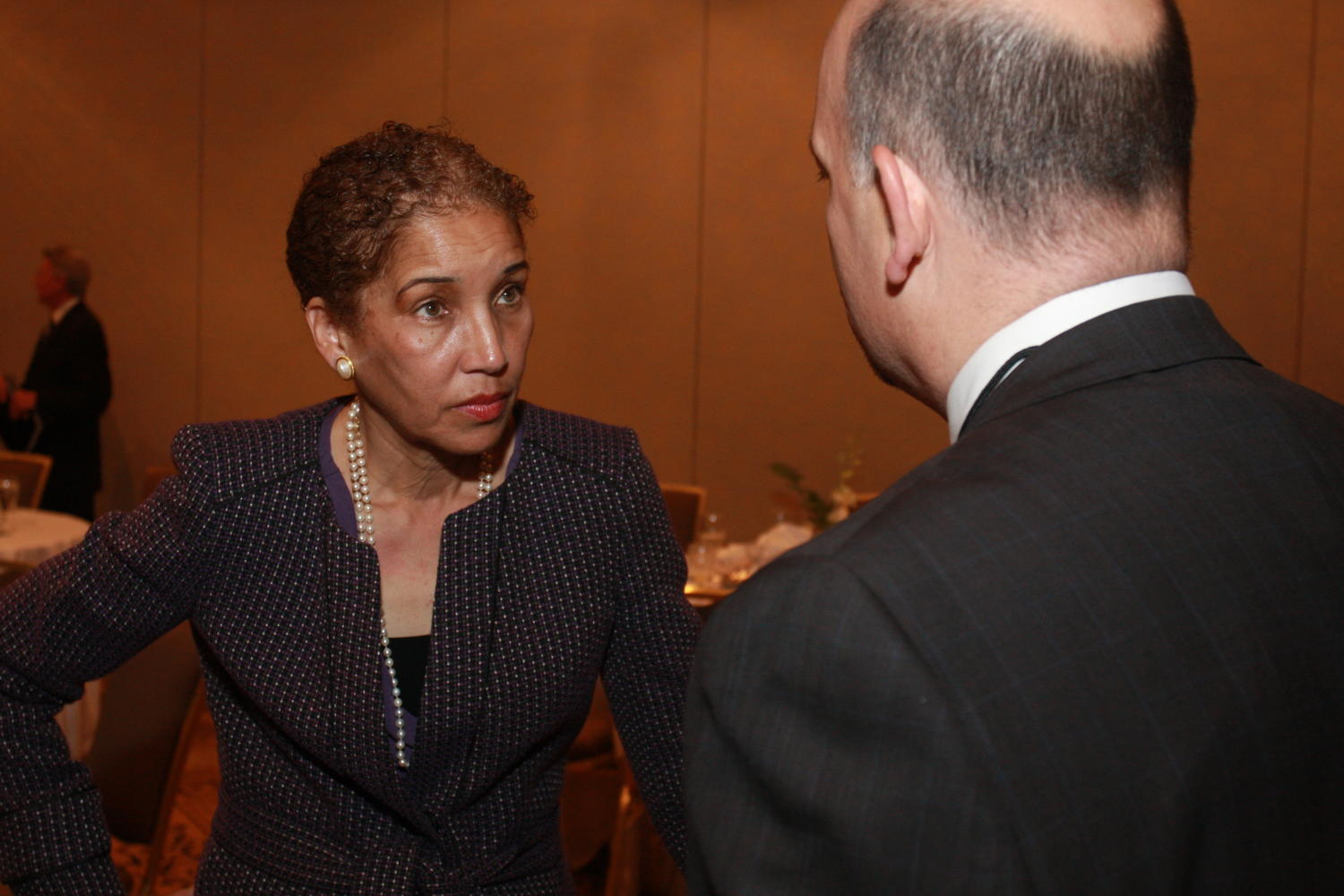 "[Guests in attendance at the TDNA conference], Photograph of an unidentified woman seen speaking with another guests as they are attending the 2010 Texas Daily Newspaper Association annual meeting held in Houston, Texas. The woman has just given a presentation titled ""Millennials and News."","