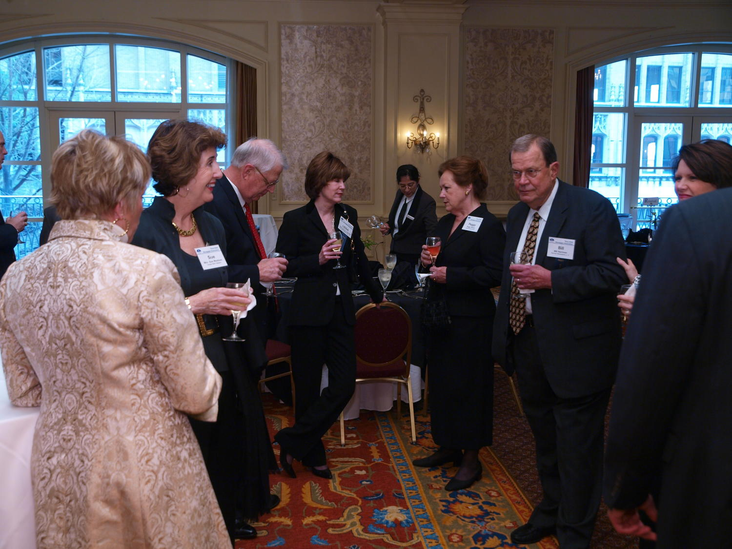 [Many guests in attendance at the TDNA dinner], Photograph of many guests, dressed in their finest attire, in attendance at the 2008 Texas Daily Newspaper Association annual conference awards dinner, held at The Westin Riverwalk Hotel in San Antonio, Texas. Sue Mayborn can be seen among the crowd of guests.,