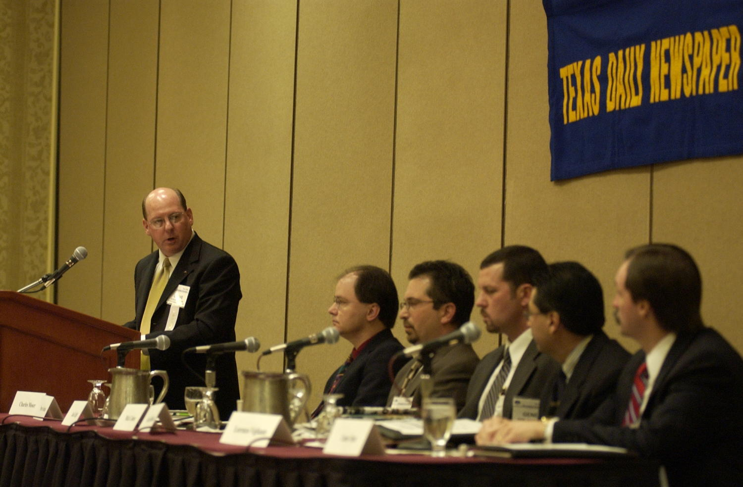 [Guests speakers at TDNA conference in Corpus Christi, 2], Photograph of from (L-R) are Steve Jordan (podium), Jack Light, Mick Cohen, Gene Haddock, Lorenzo Vigliante, and Lane Aten. They are all in attendance at the 2004 Texas Daily News Association annual conference held in Corpus Christi.,