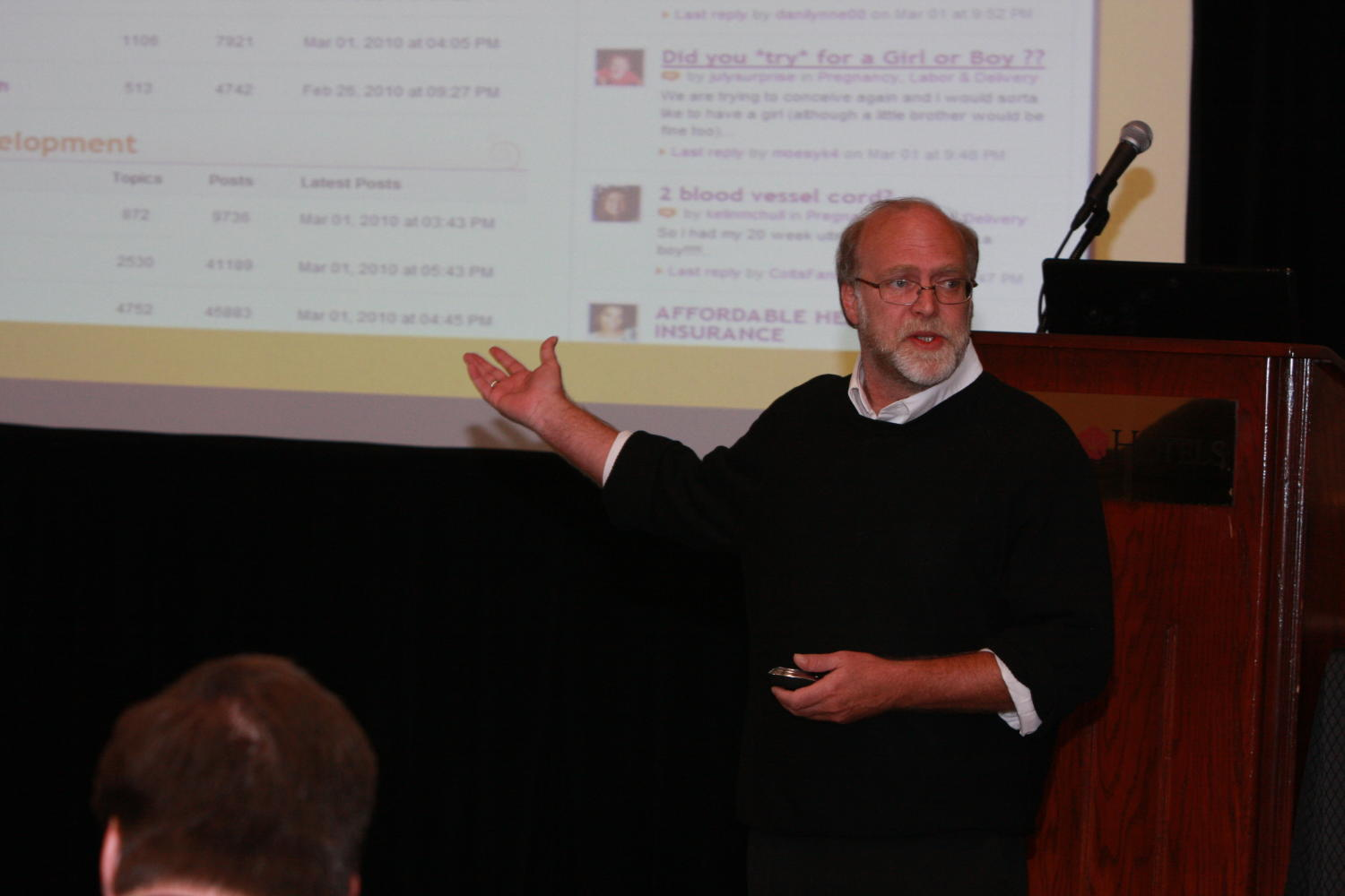 [Photograph of man giving a presentation at TDNA conference], Photograph of an unidentified man seen standing in front of a podium and giving a powerpoint presentation during the 2010 Texas Daily Newspaper Association annual meeting held in Houston, Texas.,