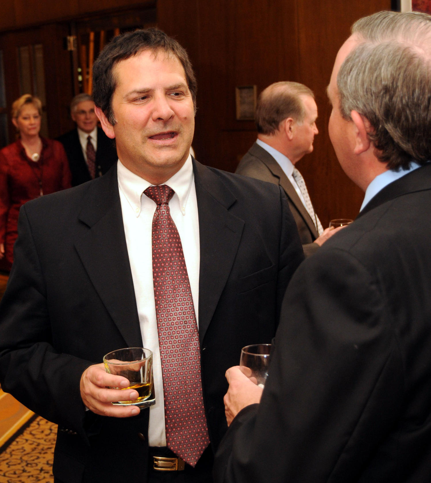 [Guests drinking and talking with one another], Photograph of guests seen chatting with one another and drinking refreshments during a reception at the 2010 Texas Daily Newspaper Association annual meeting held in Houston, Texas.,