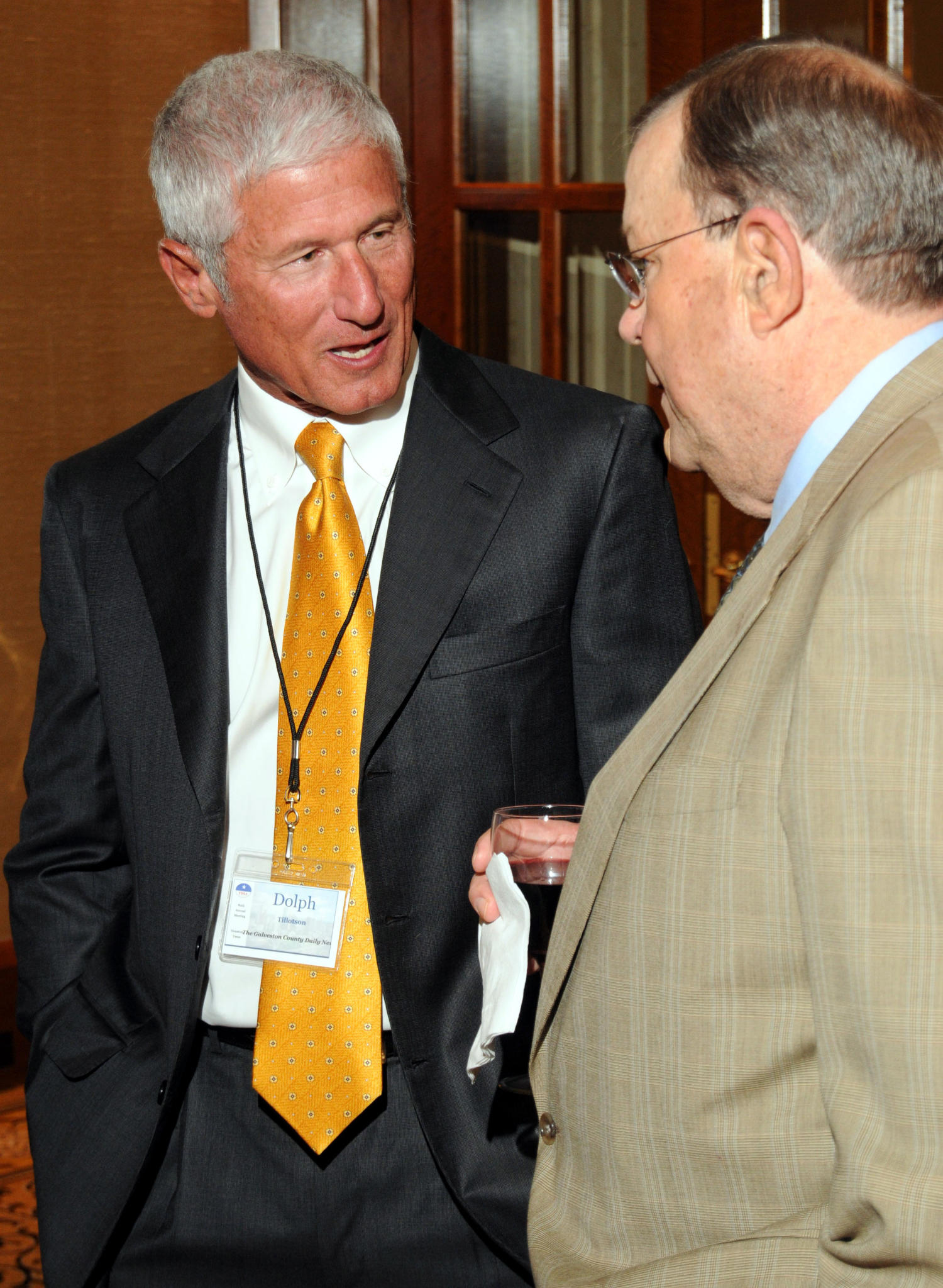 [Photograph of Dolph Tillotson], Photograph of Dolph Tillotson seen standing with another guest, drinking refreshments during a reception at the 2010 Texas Daily Newspaper Association annual meeting held in Houston, Texas.,