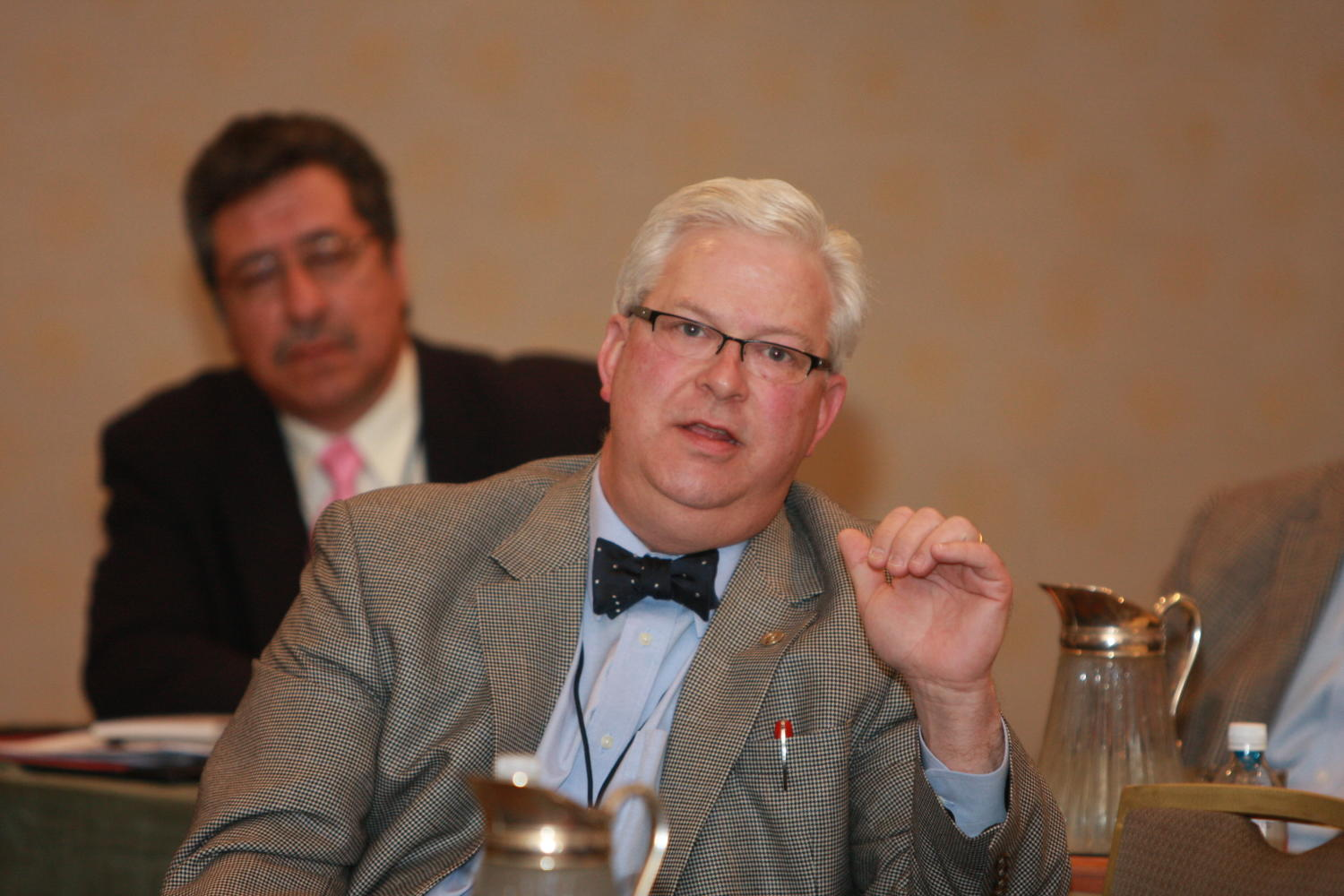 [Patrick Canty seated and attending a TDNA conference], Photograph of Patrick Canty seated at elongated tables with other guests as they are attending the 2010 Texas Daily Newspaper Association annual meeting held in Houston, Texas.,