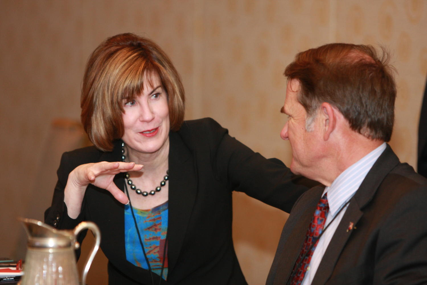 [Man and woman talking to one another at TDNA conference], Photograph of an unidentified man and woman seen talking to each other as they are attending the 2010 Texas Daily Newspaper Association annual meeting held in Houston, Texas.,