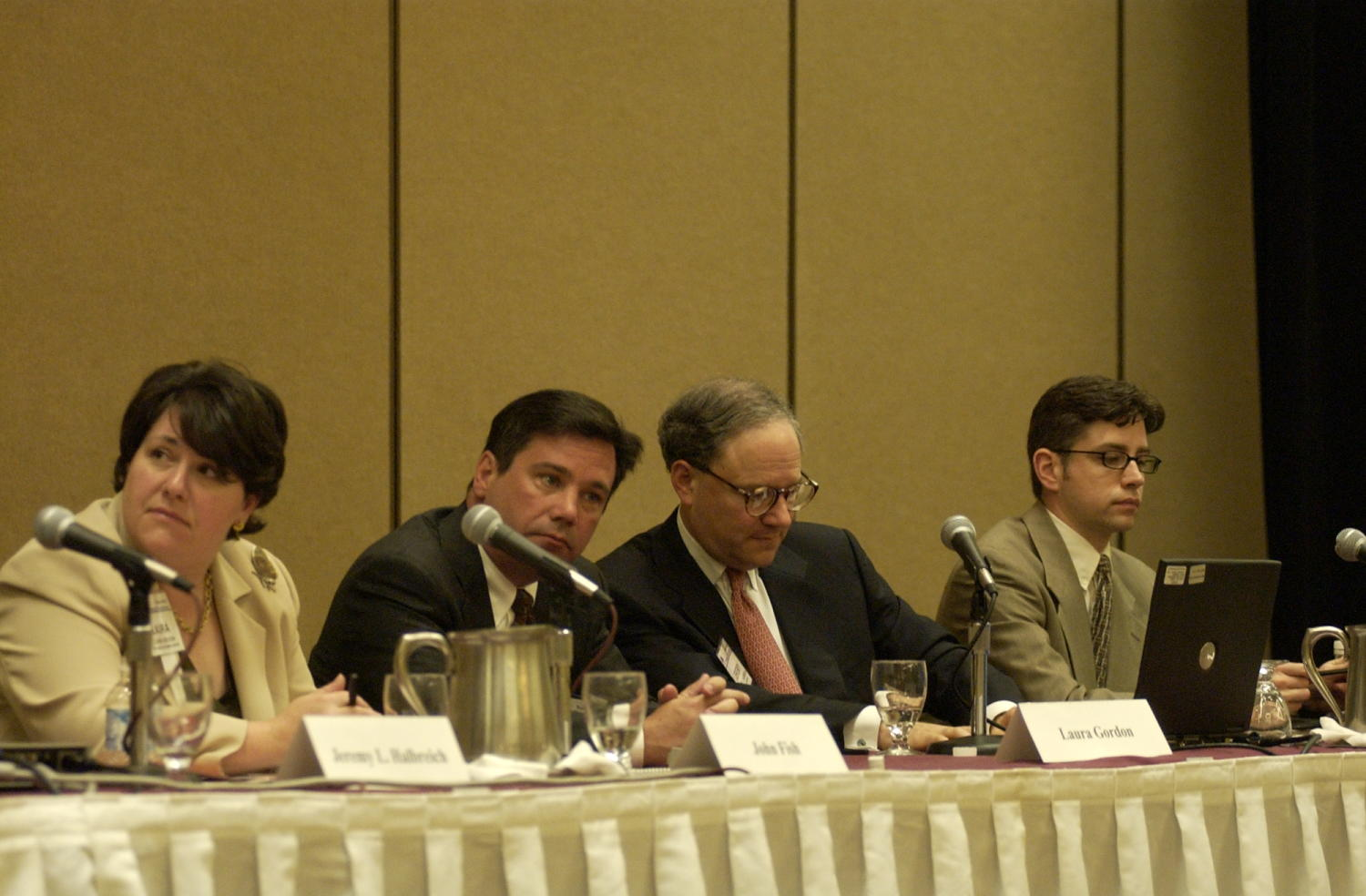 [Laura Gordon, John Fish, Jeremy L. Halbreich and Jim Lenahan], Photograph of (L-R) Laura Gordon, John Fish, Jeremy L. Halbreich, and Jim Lenahan, guest speakers attending the 2004 Texas Daily News Association annual conference held in Corpus Christi.,