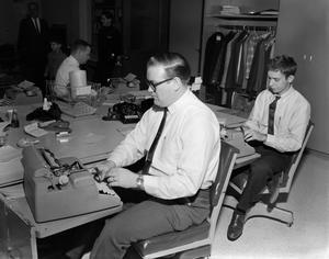 Three men using typewriters, NBC News Photographs