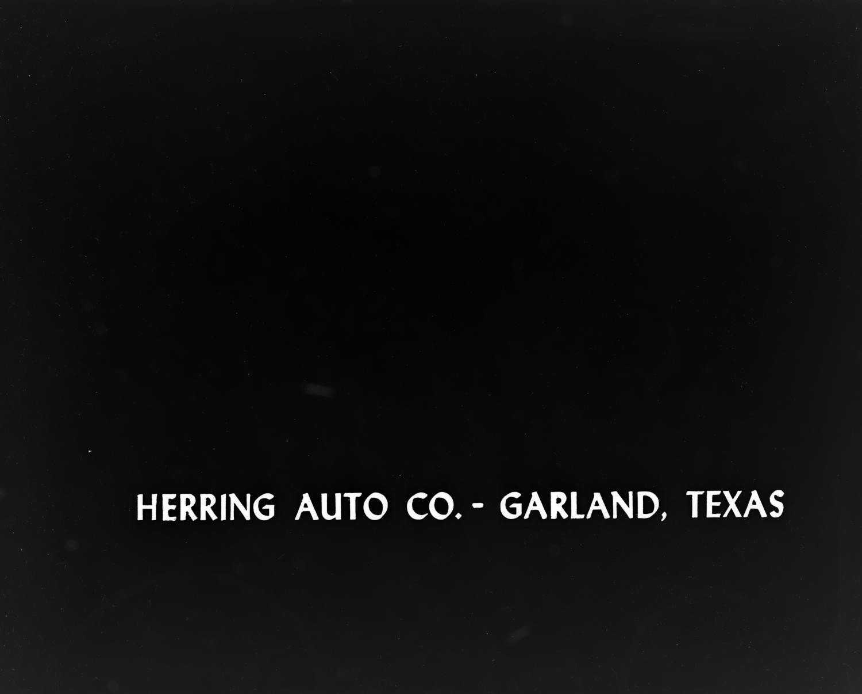 "[""Herring Auto Co. - Garland, Texas"" slide], Photograph of a slide with the text ""Herring Auto Co. - Garland, Texas"".,"