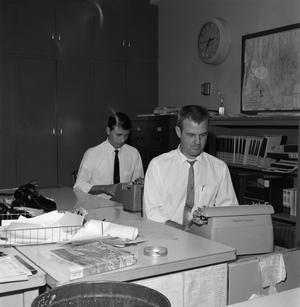 Two men using typewriters, NBC News Photographs