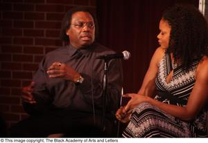 Primary view of [Curtis King talks as woman looks toward him]