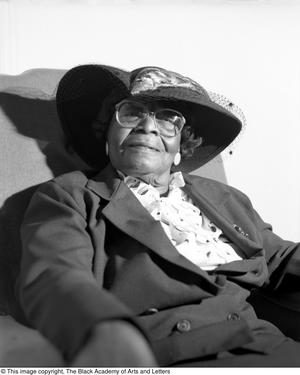 Black and white photograph of Willie Mae Butler seated.