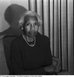 Balck and white photograph of Dr. Pearl L.W. McNeil seated.