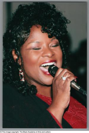 Primary view of [Unidentified singer at Christmas Kwanzaa soiree]