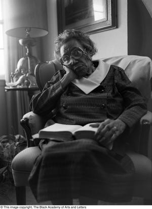 Primary view of object titled '[Photograph of Mable Chandler reading a book #3]'.