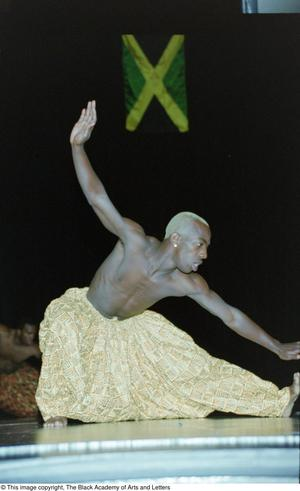 Primary view of object titled '[Male dancer in harem trouser performing at Caribbean Dance]'.