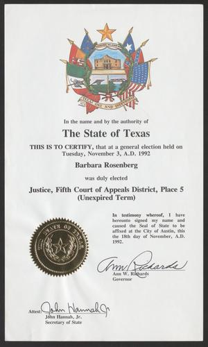 A white certificate with a colorful symbol of different flags at the top. On the bottom left of the page is a golden seal, a signature under it, and another signature to the right of it.